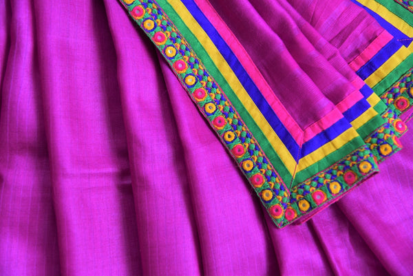 90B026 Purple plain saree with a multi-colored mirror border available at our Indian clothing store in USA. The tussar saree, available at our Indian ethnic wear store makes a great Indian wedding reception outfit, as well as a wonderful party wear saree.