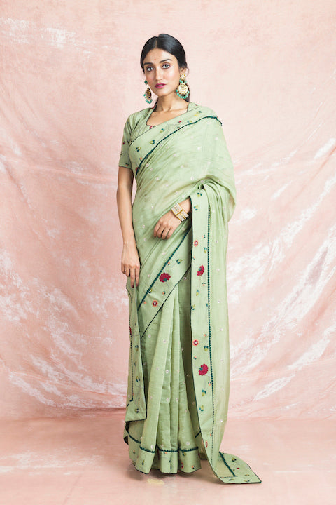 Shop elegant pista green embroidered Banarasi chanderi saree online in USA with sari blouse. Champion ethnic fashion on weddings and festivals with a stunning collection of Banarasi sarees, handloom sarees with blouse, bridal sarees, from Pure Elegance Indian fashion store in USA.-full view