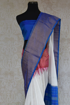 90B767 A silk ikkat saree that makes for a lovely & simple Indian outfit. The blue white & red sari can be bought online at our ethnic Indian wear store online in USA. For get-togethers, pujas and festivities, this simple saree is a great pick!