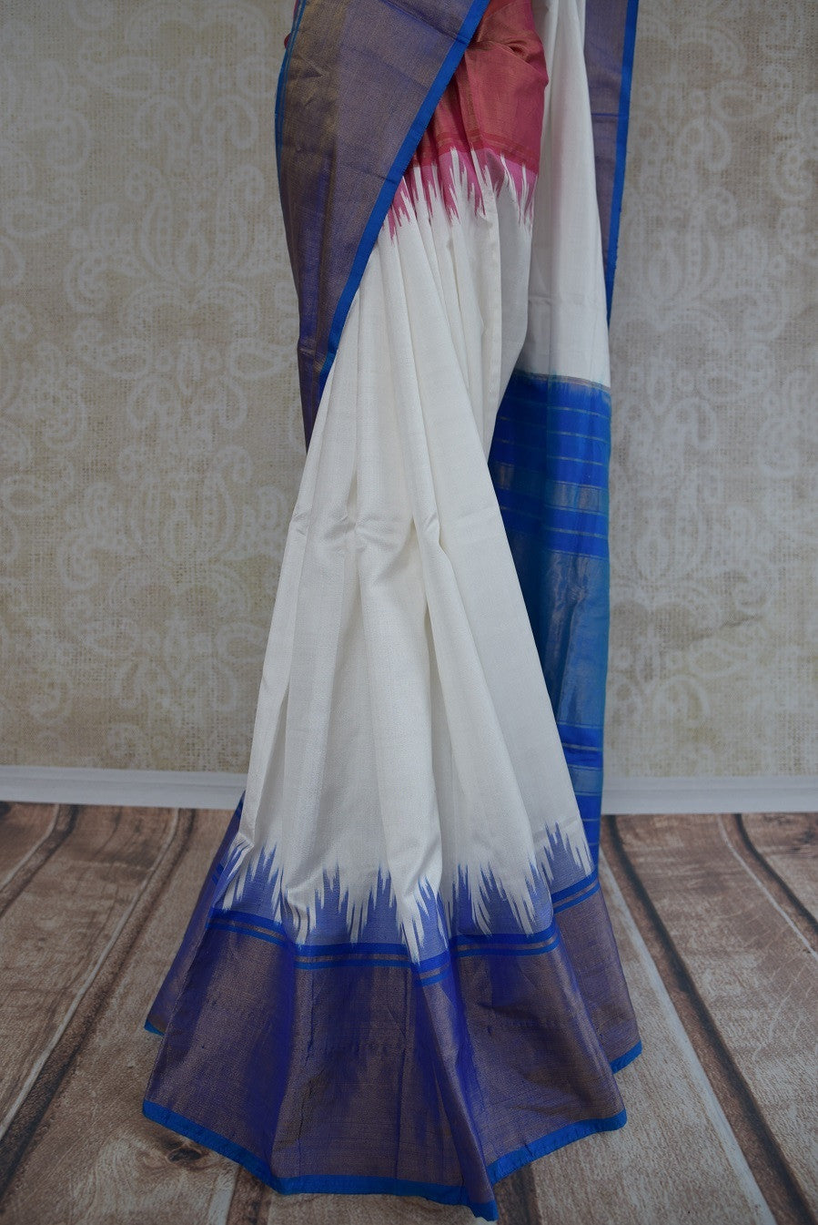 90B767 A silk ikkat saree that makes for a lovely & simple Indian outfit. The blue white & red sari can be bought online at Pure Elegance - our Indian wear store online in USA. Versatile and beautiful, this simple saree is an evergreen style hit!