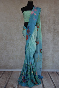90C165 Shaded blue crepe saree, ideal for pujas and festivities. Buy this traditional floral printed saree online in USA at our ethnic clothing store - Pure Elegance. This one is a timeless beauty.
