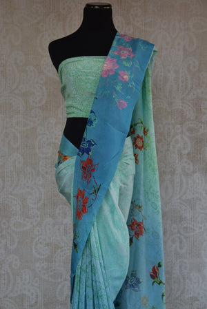 90C165 Shaded blue crepe saree, ideal for pujas and festivities. Buy this traditional floral printed saree online in USA at our ethnic clothing store - Pure Elegance. This one is an evergreen saree you will love having in your Indian wear wardrobe.