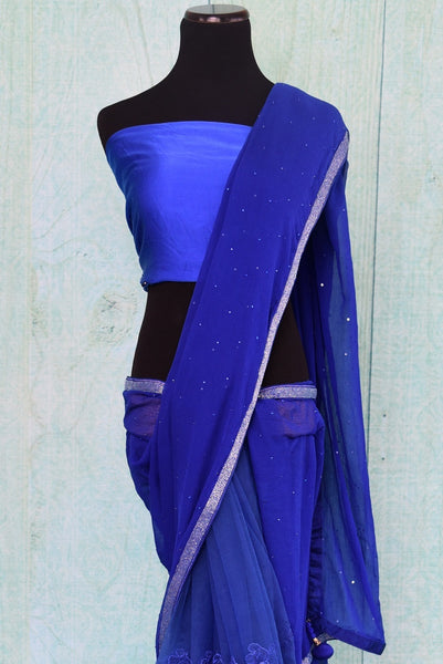 90C214 A half lace and half chiffon saree in a bold blue color that is sure to steal hearts. Buy this ethnic party wear saree online in USA at our Indian clothing store - Pure Elegance. This striking saree is a must have Indian outfit this season.