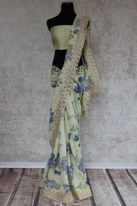 90C198 Matka printed floral saree available at our ethnic wear store. The pastel green party wear saree will be a great addition to your Indian clothing collection and is sure to flutter hearts wherever you go!