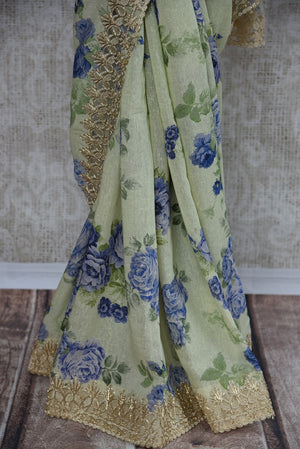 90C198 Matka printed floral saree available at our ethnic wear store. The pastel green party wear saree will be a great addition to your Indian clothing collection. This beautiful saree is a must-have in your Indian wear wardrobe this season.