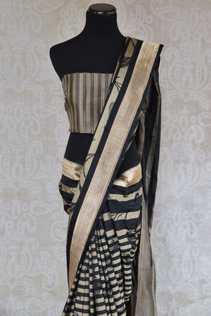 90B922 Black, beige & gold Banarasi silk saree online in USA. The striped & floral sari is available at Pure Elegance. Buy this party wear saree today!