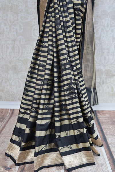 90B922 Bold black, beige & gold Banarasi silk saree. The striped & floral sari makes for the perfect party wear sari. Buy this ethnic Indian outfit online at our Pure Elegance - online and in Edison, USA.