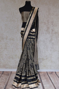 90B922 Black, beige & gold Banarasi silk saree. The striped & floral sari makes for the perfect party wear sari this season. Buy this ethnic Indian outfit online at our store in USA, Pure Elegance.