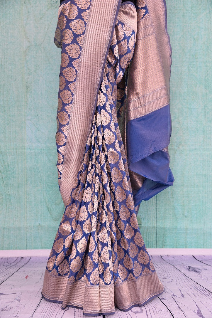 90C250 Blue and golden Banarasi silk (kathan) saree available online in USA at our Indian wear store. The traditional saree from India is a timeless ethnic outfit. This lovely saree is sure to have you looking ravishing.