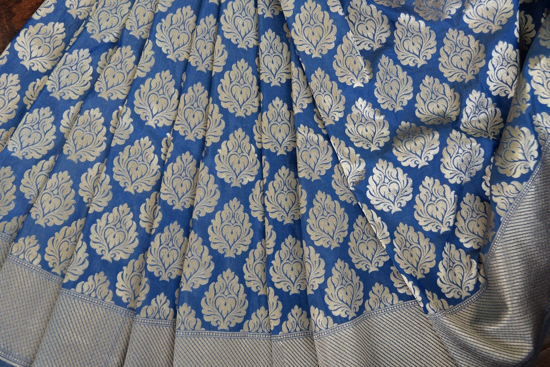 90C250 Blue and golden Banarasi silk (kathan) saree available online in USA at our Indian wear store. The traditional saree from India is a timeless ethnic outfit. This pretty saree is one you just cannot go wrong in!