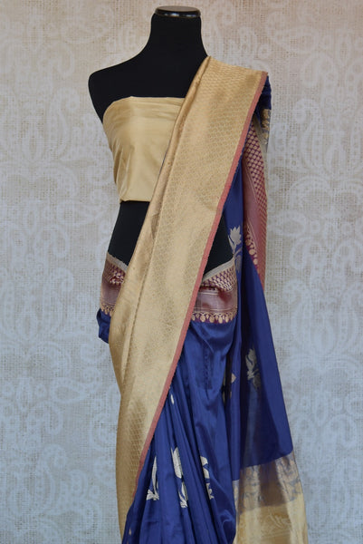 90C287 Banarasi silk saree from Indian available at our ethnic wear store online in USA. The dark blue saree with cream gold border is ideal for festive occasions. This Indian saree is an ethnic fashion delight!