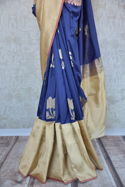 90C287 Banarasi silk saree from Indian available at our ethnic wear store online in USA. The dark blue saree with cream gold border is ideal for festive occasions. Buy this timeless saree today!