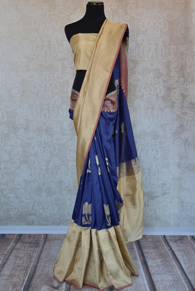90C287 Banarasi silk saree from Indian available at our ethnic wear store online in USA. The dark blue saree with cream gold border is ideal for festive occasions. This stunning saree is sure to get all the heads turning!