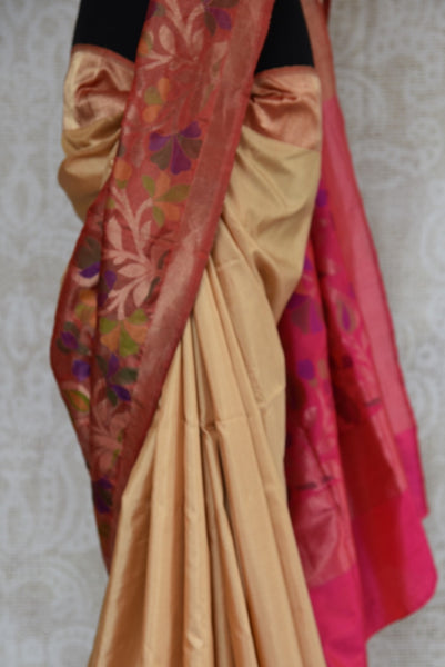 90B619 Beige Banarasi saree has a beautiful pink Paithani border and pallu. This traditional saree can be bought at our Indian clothing store in USA (Edison) & online. This ethnic outfit has a timeless appeal and beauty!