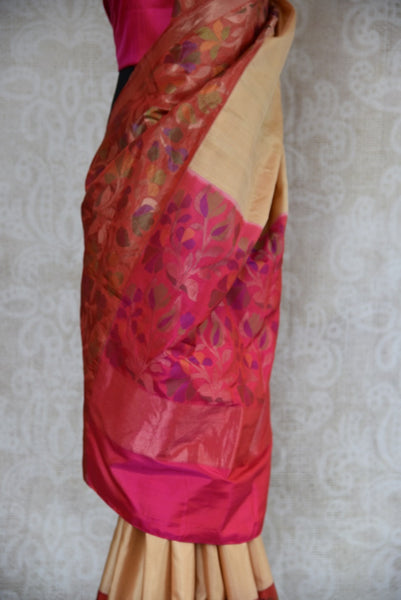 90B619 Beige Banarasi saree has a beautiful pink classic Paithani border and pallu. This traditional saree from India can be bought at our Indian clothing store - Pure Elegance in USA (Edison) & online. This ethnic outfit has an evergreen charm to it.