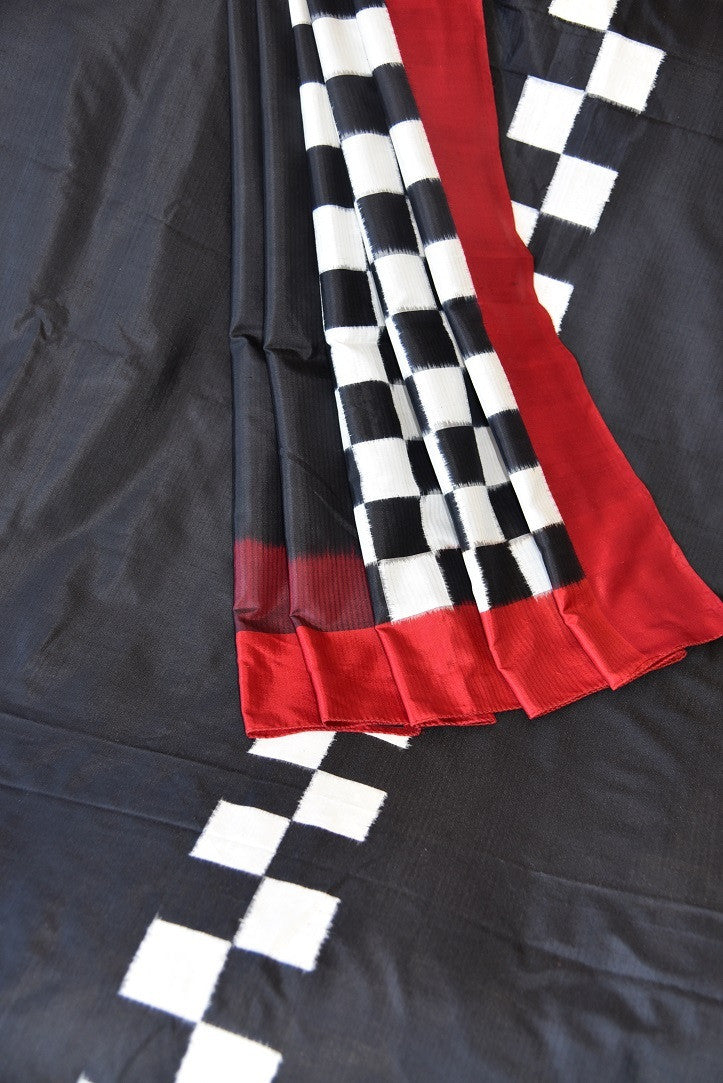 90C555 Black Silk Ikkat Saree With Pops Of Red & White