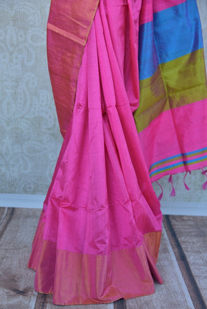 90C294 Simple raw silk saree available at our ethnic clothing store in USA. The pink saree comes with a blue blouse and is a great choice for pujas and festivals. This versatile saree is a sure shot stunner for all seasons and days!