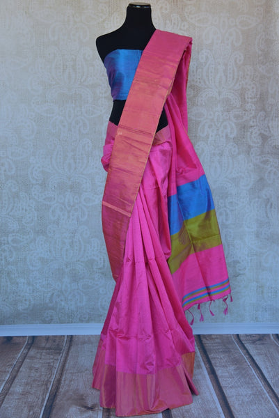 90C294 Simple raw silk saree available at our ethnic clothing store in USA. The pink saree comes with a blue blouse and is a great choice for pujas and festivals. This classic saree is simple, yet striking!