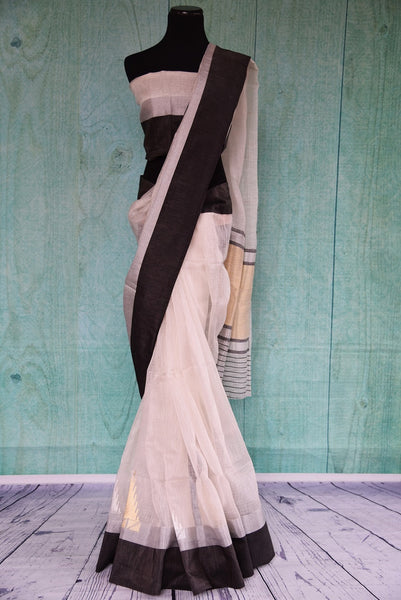 90B988 Buy this black & white sari with gold & silver work at our Indian wear store online. The traditional chanderi saree makes for ideal ethnic festive wear and party wear that's simple, yet bold.