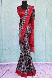 90B385 Want to buy a modern sari? Shop for this checked black white & red ikkat sari at our online Indian clothing store online Pure Elegance. This party wear saree is sure to have you looking chic all day/night long!