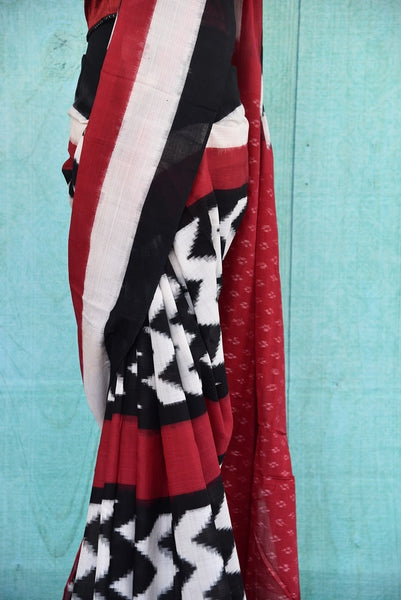 90B387 A contemporary Indian saree in the classic color combination of red, black and white. The printed sari can be purchased from Pure Elegance online or at our Indian fashion store in Edison.