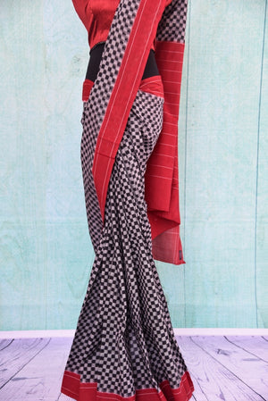 90B385 Want to buy a modern sari online in USA? Shop for this checked black white & red ikkat sari at our Indian clothing store - Pure Elegance. This party wear saree is sure to have you looking chic.
