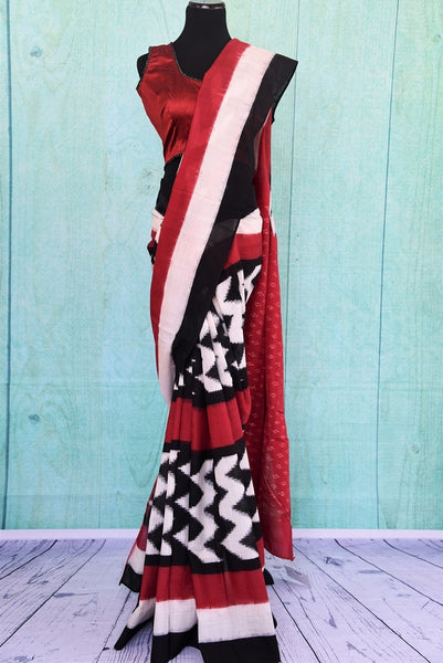 90B387 A contemporary Indian outfit in the classic combination of red, black and white. The traditional printed sari can be purchased from Pure Elegance online or at our ethnic store in Edison.