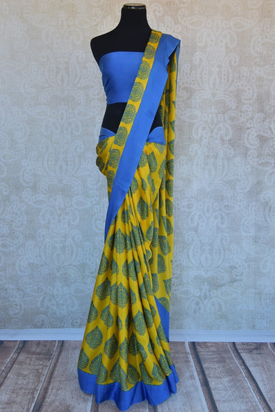 90B573 This vibrant satin crepe saree makes for the ideal party wear Indian outfit. Buy this lovely printed yellow & blue sari online at our Indian clothing store online in USA - Pure Elegance.