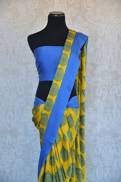 90B573 This vibrant satin crepe saree is a great choice as a party wear Indian outfit. Buy this charming printed yellow & blue sari online at our Indian wear store online in USA - Pure Elegance.