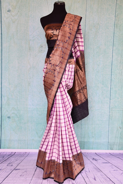90B617 Buy this checked contemporary saree online at Pure Elegance. The pink & purple mugha silk saree with black border is perfect for festive Indian occasions and parties. This unique saree is sure to keep all eyes on you wherever you go!