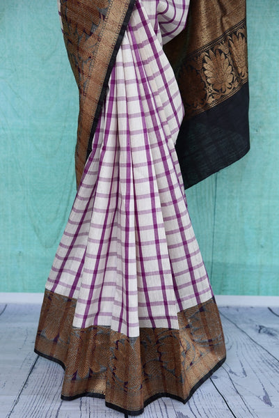 90B617 Buy this checked contemporary saree online at Pure Elegance in USA. The pink & purple mugha silk saree with black border is perfect for festive Indian occasions and parties. This unique saree is sure to turn heads!