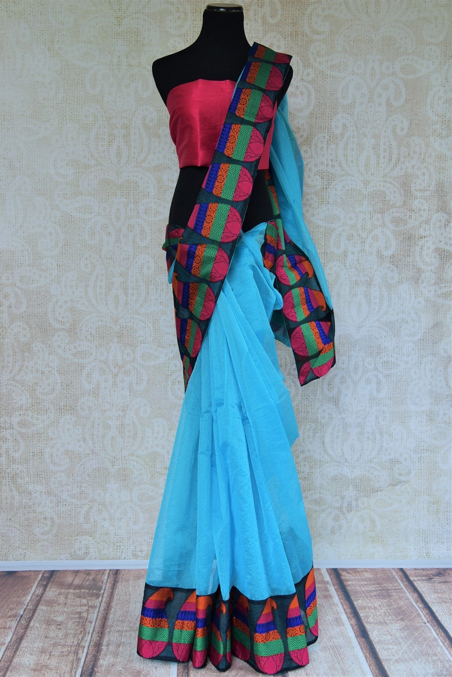 90B953 This cotton kora sari with Banrasi border makes for an ideal festive and party wear saree. You can buy this blue sari with pink blouse online at our Indian clothing store in USA.