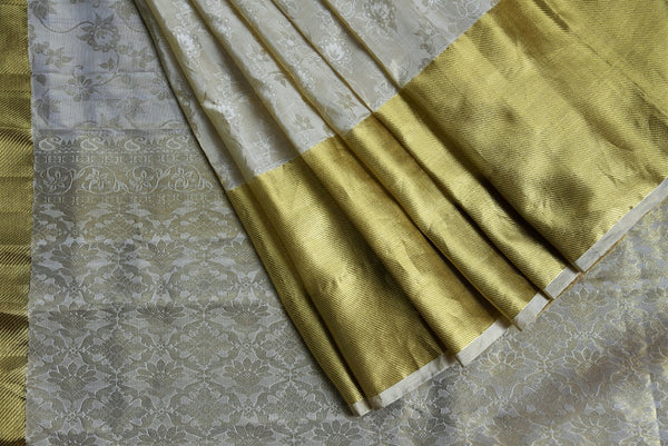 90C454 Cream Kanchipuram Saree With Self Woven Flowers