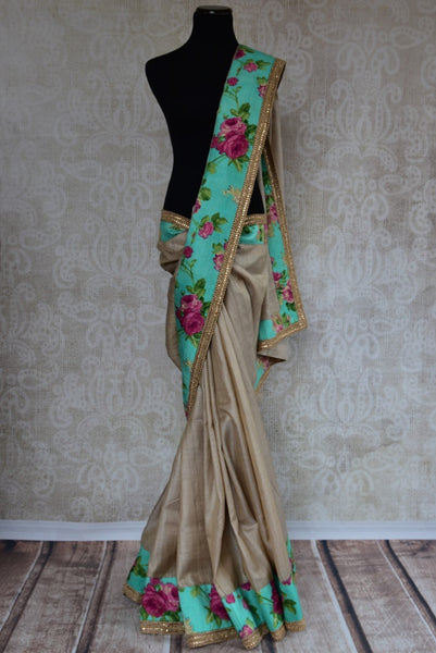 90C203 Lovely golden-beige tussar silk saree with floral border and blouse in a refreshing sea green color. This party wear saree from India can be bought in USA at our Indian clothing store online.