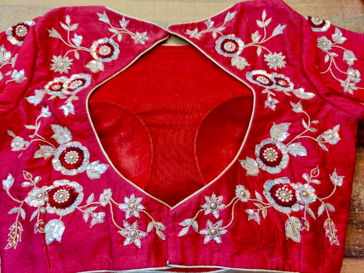 Shop bright red embroidered designer sari blouse online in USA. Elevate your ethnic saree style with a tasteful collection of designer saree blouses, embroidered sari blouses, Banarasi blouses, silk saree blouses from Pure Elegance Indian clothing store in USA.-back