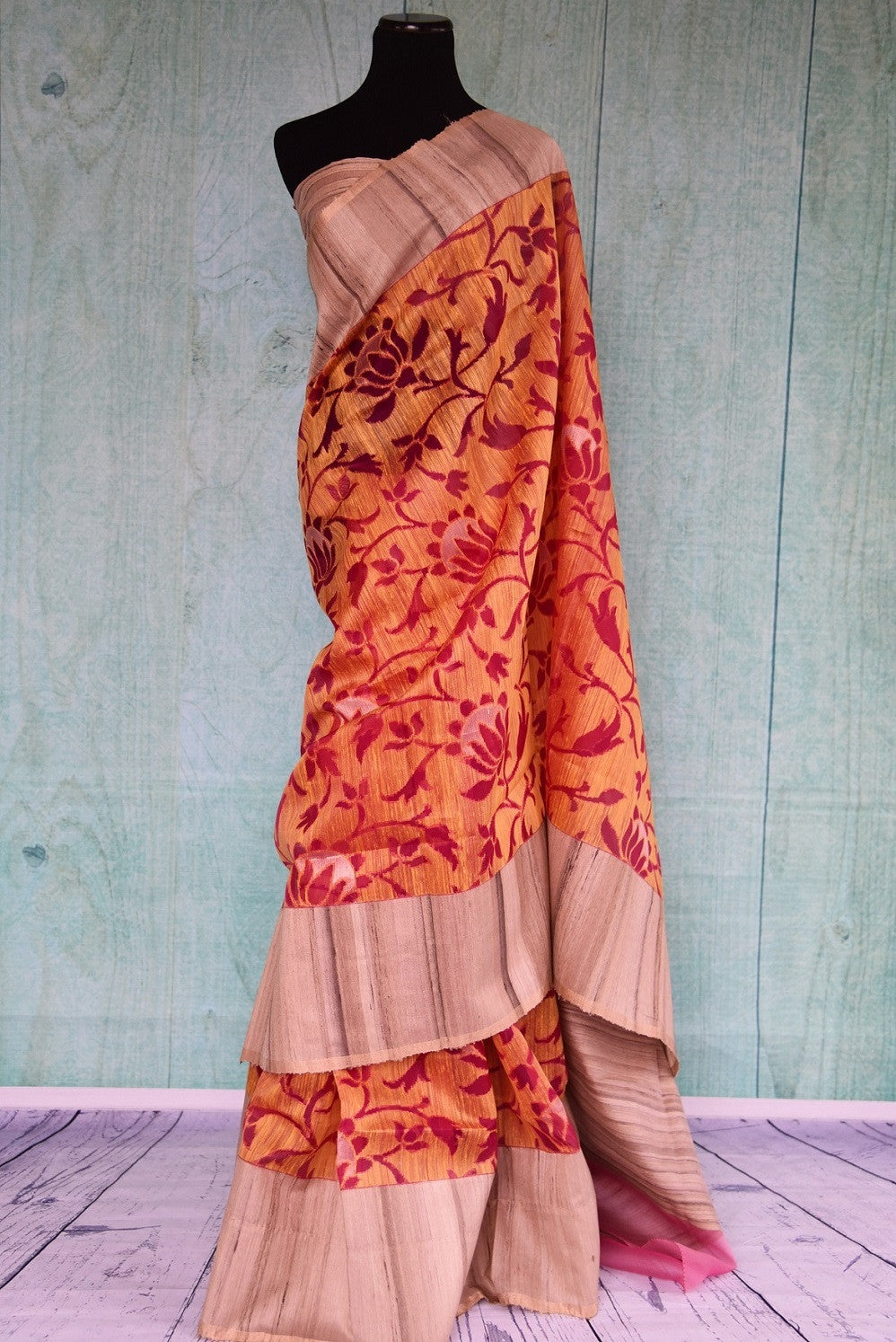 90B315 This lovely orange & red floral saree makes for the perfect festive Indian wear. The matka jute sari can be bought at our ethnic Indian clothing store in USA online or in Edison.