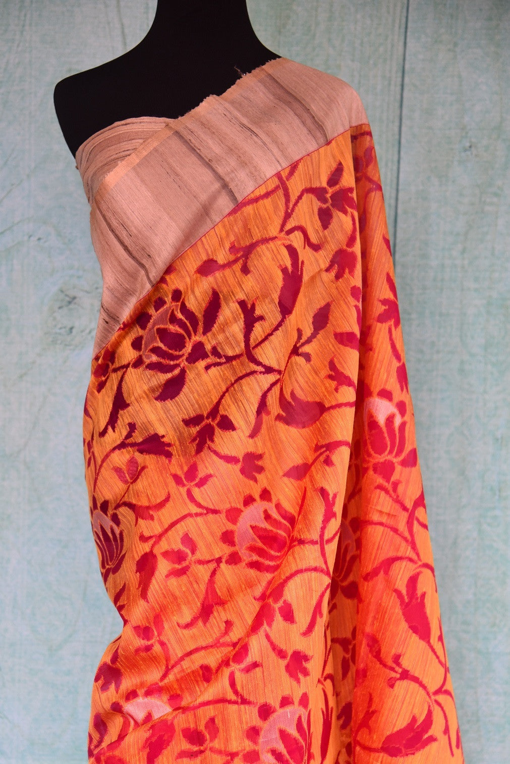 90B315 This lovely floral saree in orange and red hues makes for the perfect festive Indian wear for all seasons. The matka jute sari can be bought at our ethnic Indian clothing store in USA online or in Edison.