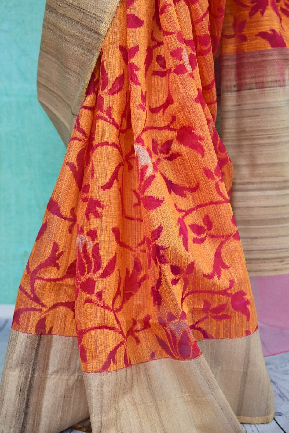 90B315 This lovely orange & red floral saree is a great pick for festive occasions, weddings and pujas. The matka jute sari can be bought at our ethnic Indian clothing store in USA online or in Edison.