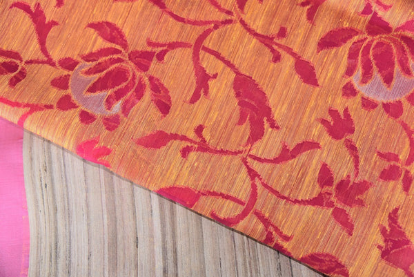 90B315 This splendid orange & red floral saree makes for the perfect festive Indian wear. The matka jute sari can be bought at our ethnic Indian wear store in USA online or in Edison - Pure Elegance.