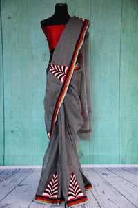 90C077 Grey Bengal handloom saree with pops of black, red and white. The party wear saree is available to buy at our Indian clothing store in USA - Pure Elegance. This unique saree is sure tot urn heads wherever you go.
