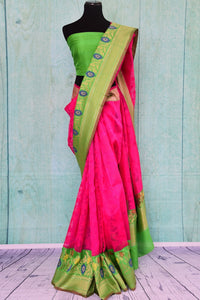 90B969 Bright pink and green matka organza Banarasi saree with a pop of blue. The festive and party wear saree is available at our Indian clothing store online in USA. This beautiful saree from Indian is absolutely not to be missed!