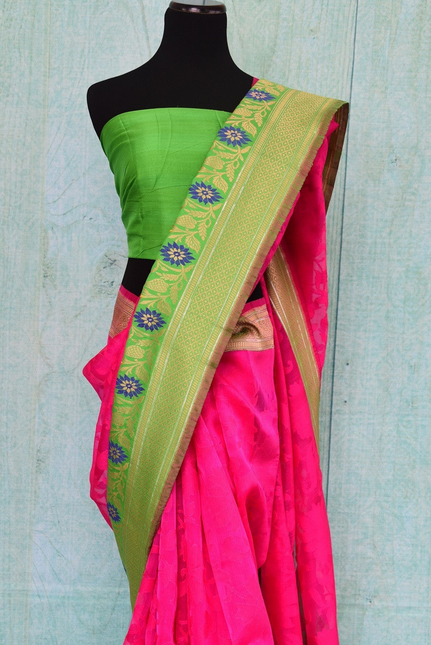 90B969 Get set to keep all eyes on you in this bright pink and green matka organza Banarasi saree with a dash of blue. The party wear saree is available at our Indian clothing store online in USA. This beautiful saree from Indian is absolutely not to be missed!