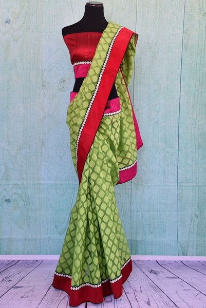 90A821 Green jute saree with a bright red border that makes for a classic Indian outfit. The simple traditional saree can be bought at our Indian ethnic wear store - Pure Elegance, online in USA.