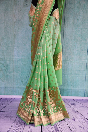 90B984 Buy this pista green and gold Benarasi saree with floral design on the borders online in USA at Pure Elegance. The traditional saree makes for an ideal ethnic outfit for Indian weddings.