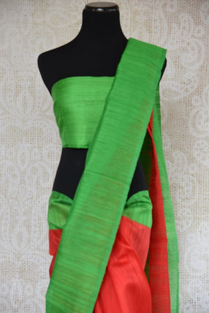 90B326 This vibrant red matka gicha saree with a green border is an ideal Indian outfit to wear for festive occasions. The simple woven sari is available at our Indian ethnic wear store Pure Elegance.