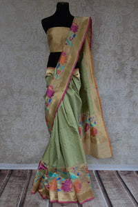 90B251 Green matka Banarasi saree with paithani border. This floral saree makes for the perfect Indian outfit for wedding functions & pujas and can be bought online in USA from Pure Elegance - our ethnic fashion store.
