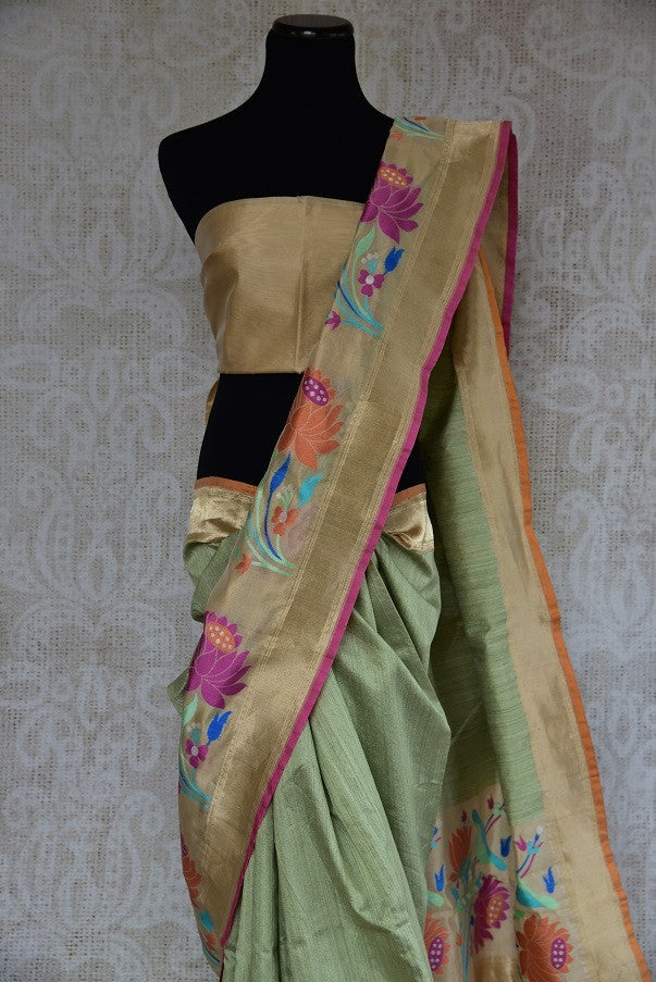 90B251 Lovely green matka Banarasi saree with paithani border. This floral saree is a great pick for wedding functions & pujas and can be bought online from Pure Elegance - our Indian clothing store in USA.