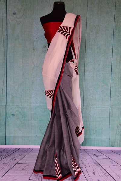 90C076 This grey, white and red Bengal handloom saree with pops of black is an ideal choice for party wear.  The bold and striking sari can be bought online at our ethnic Indian wear store, Pure Elegance online and in Edison, USA.