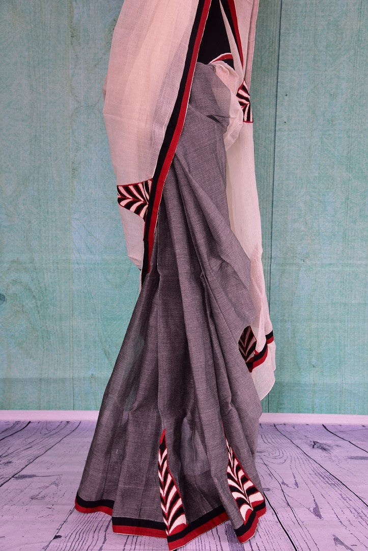 90C076 Coming in a unique color combination of grey, white and red, this Bengal handloom saree with pops of black makes for a great party wear saree.  The bold and striking sari can be bought online at our online Indian clothing store in USA - Pure Elegance online.