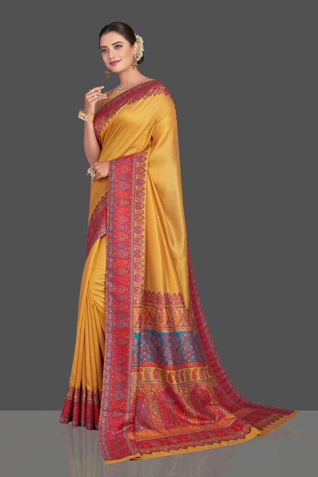 Shop mustard yellow Kani weave tussar muga silk sari online in USA. Make your presence felt on special occasions in beautiful embroidered sarees, handwoven saris, pure silk saris, tussar sarees from Pure Elegance Indian saree store in USA.-full view